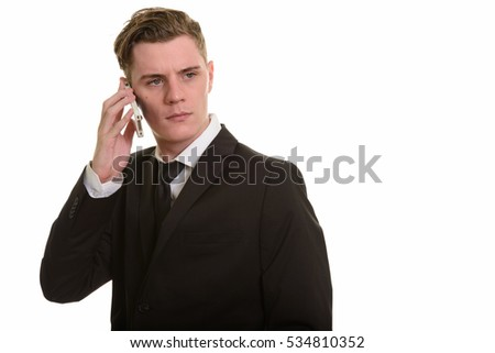 Young handsome Caucasian businessman talking on phone
