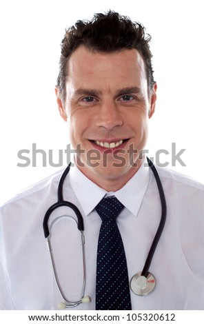 Young handsome doctor. Closeup portrait of smiling man - stock photo