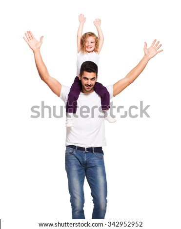 young handsome father with little daughter on his shoulders, playing and smiling, isolated on white