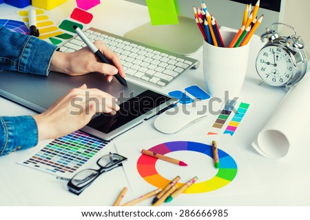 Young Handsome Graphic Designer Using Graphics Stock Royalty