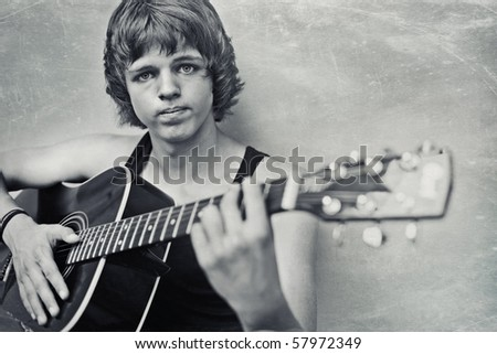 young handsome guy with a guitar. - stock photo