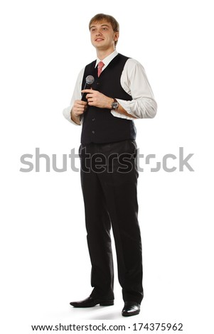 Young handsome guy with microphone in hands  - stock photo