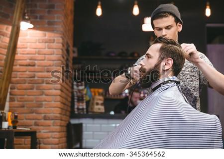 Miraculous Young Handsome Hairstylist Making Mens Haircut Stock Photo Short Hairstyles Gunalazisus