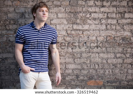 Young handsome happy man with blond hair. - stock photo