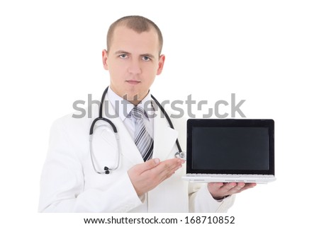 young handsome male doctor showing laptop with copy space isolated on white background - stock photo