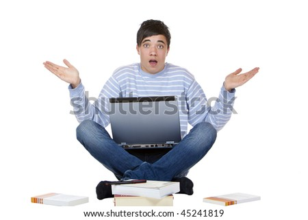 Young handsome male student with laptop is sitting on floor and learning for his exam has no idea how to manage it. Isolated on white.