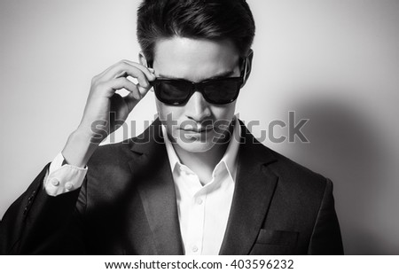 Young handsome male wearing suit and sunglasses.  - stock photo