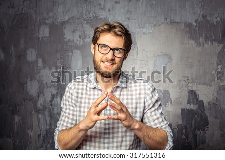 Young handsome man anticipating benefits - stock photo