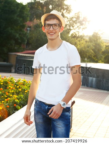 Young handsome man dressed in the style of hipster - stock photo