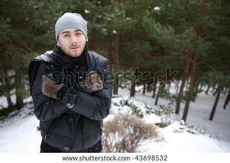 Young handsome man frozen at forest. - stock photo