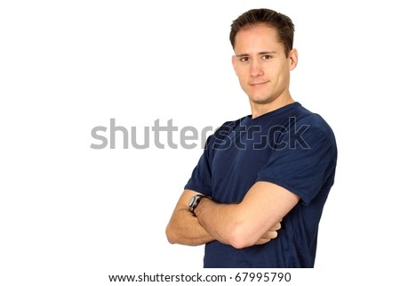 Young handsome man in a fitness T-shirt with his arms crossed - stock photo