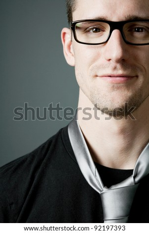 Young handsome man in black t-shirt and tie. - stock photo