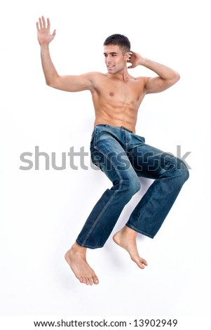 young handsome man in blue jeans on white