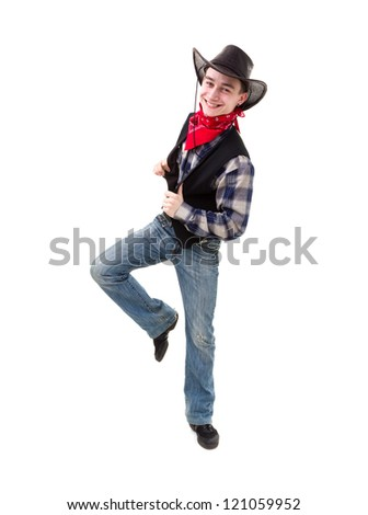 Young handsome man in cowboy's hat dancing against isolated white background - stock photo