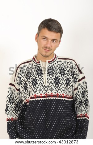 Young handsome man in winter knit warm clothes - stock photo