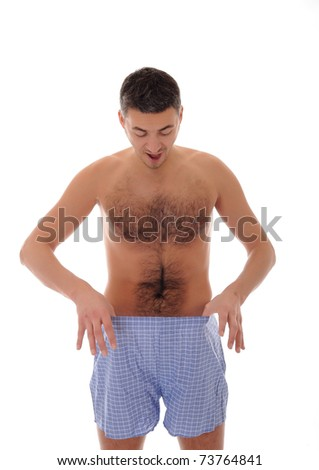 Young handsome man looking in his pants - stock photo