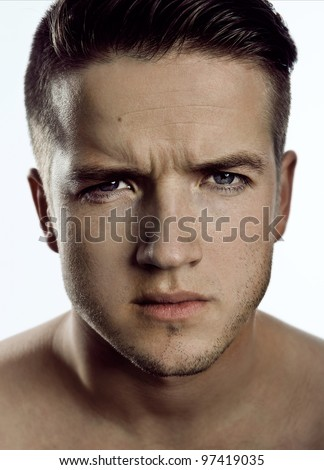 young, handsome man on white background - stock photo