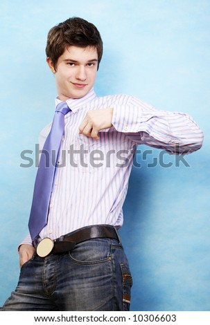 young handsome man over blue - stock photo