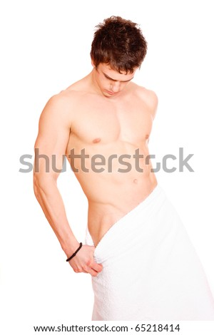 Young, handsome man overwraped by towel. Isolated on White background