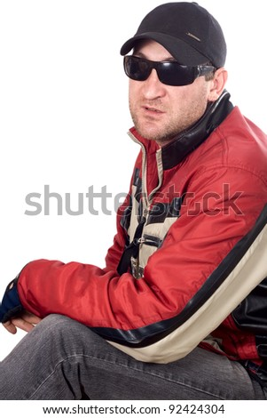 Young handsome man portrait with sunglasses and winter jacket