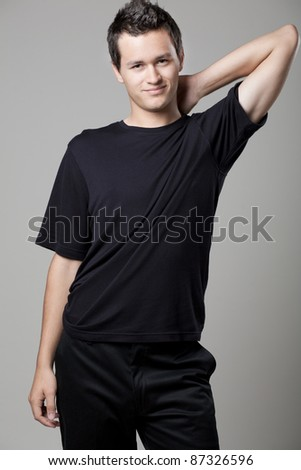 Young handsome man posing in black shirt. - stock photo