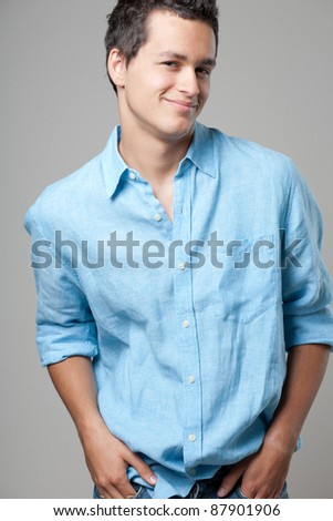 Young handsome man posing in blue shirt. - stock photo