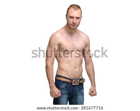 Young handsome man posing in the studio in jeans and with a naked torso