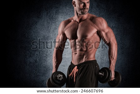 young handsome man posing on a sports camera - stock photo