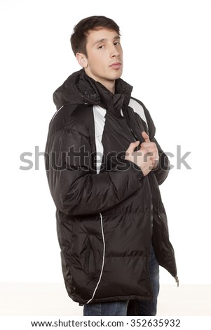 young handsome man posing with winter jacket