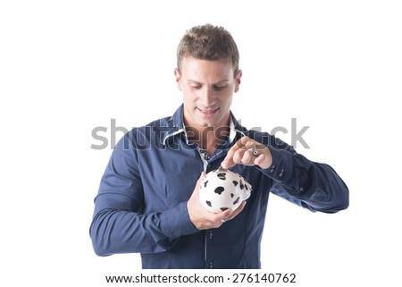 Young handsome man putting coin in piggy-bank, isolated on white background - stock photo