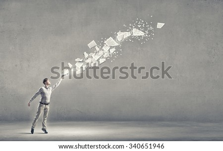Young handsome man reaching hand with book - stock photo