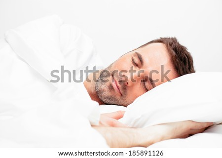 Young handsome man sleeping - stock photo