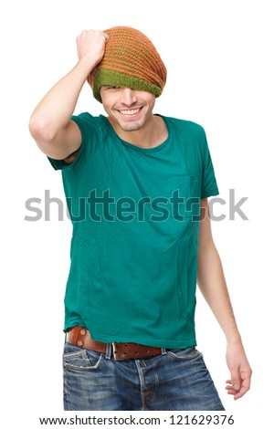 Young Handsome man smiling and wearing colorful clothing and a winter hat. Isolated on white background - stock photo
