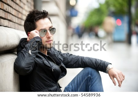 Young handsome man speaking on the phone - stock photo
