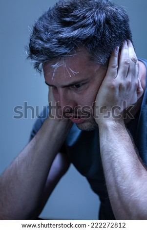 Young, handsome man suffering from nervous breakdown - stock photo
