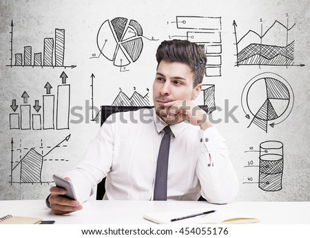 Young handsome man thinking about something sitting in armchair in white shirt and gray tie. Concept of thinking. - stock photo
