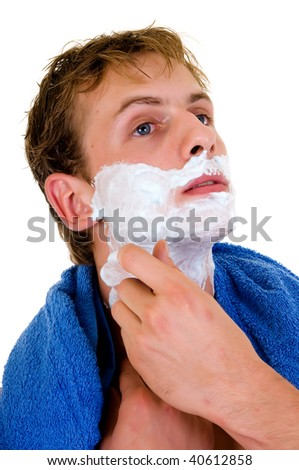 Young handsome man towel around neck, shaving,  Studio shot, white background