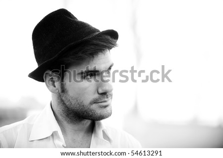 Young handsome man wearing black hat. - stock photo