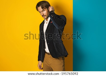 Young handsome man wearing jacket - stock photo