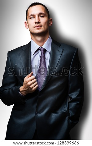 Young handsome man wearing  suit and tie - stock photo