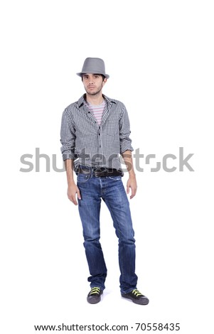 Young handsome man with a modern style, jeans, shirt and a hat - stock photo