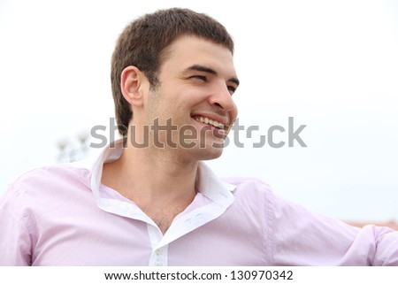 Young handsome man with great smile, outdoors portrait - stock photo