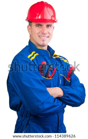 Young handsome mechanic with hard hat and tools and in overalls isolated on white.