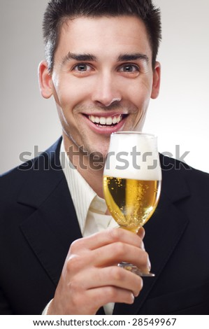 young handsome men drinking cold beer portrait - stock photo