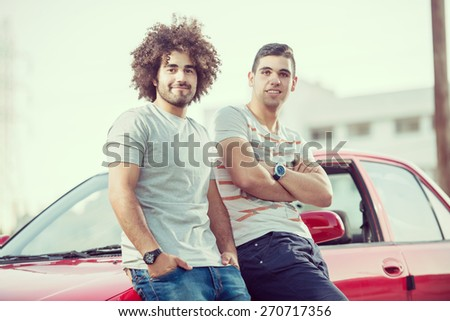 Young handsome men with car - stock photo
