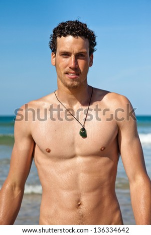 -young-handsome-muscular-man-in-a-bathing-suit-hanging-on-the-beach ...