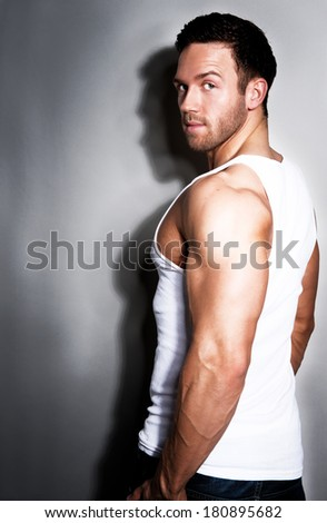 Young handsome muscular man in white t-shirt  - stock photo