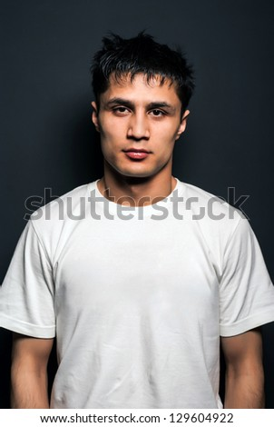 Young handsome muscular man in white t-shirt after training - stock photo