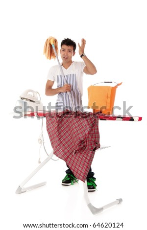 Young handsome Nepalese man stressed, ironing and cleaning. Studio shot, white background. - stock photo