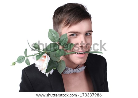 Young handsome stylish man in a jacket with a flower  - stock photo